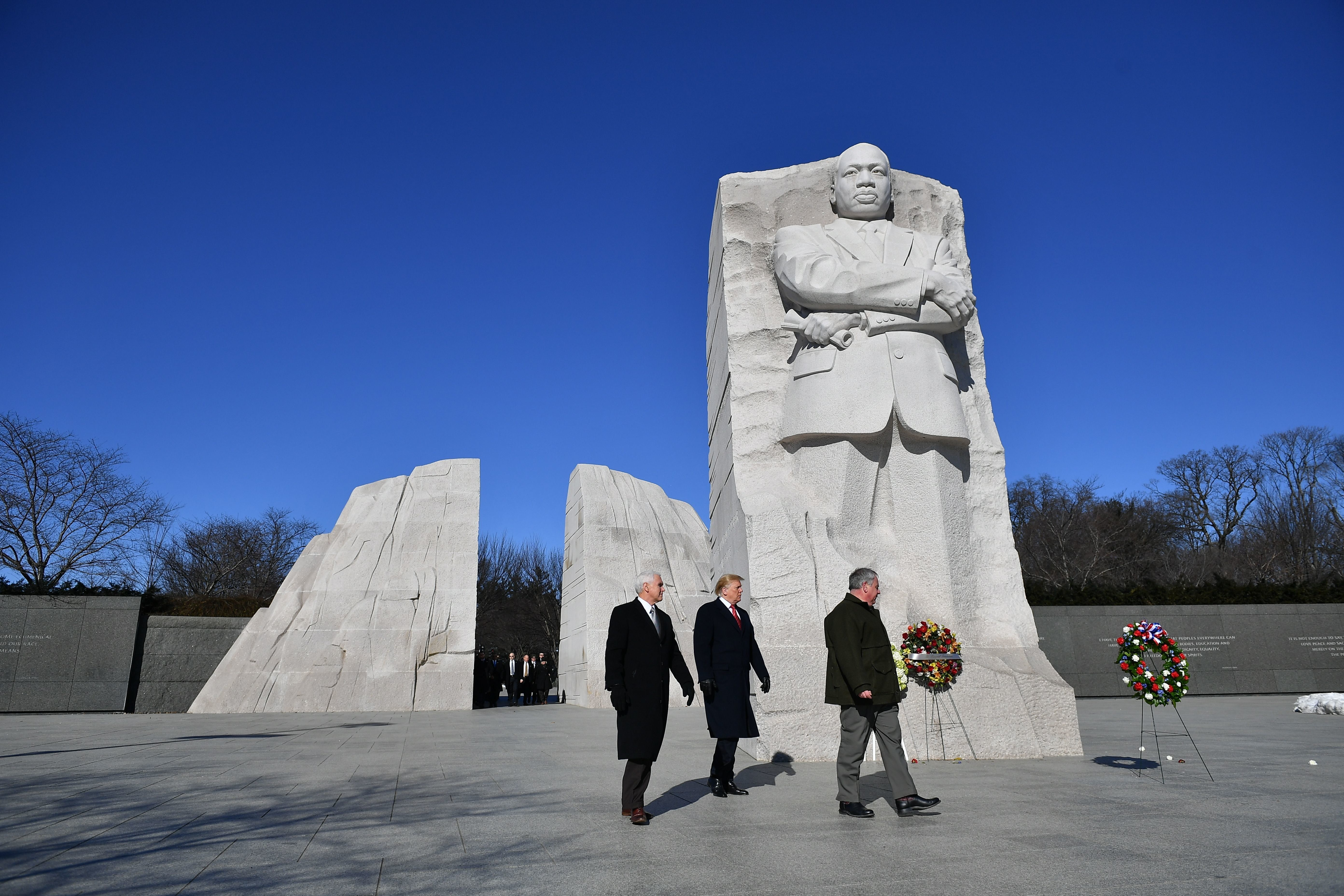 US President Donald Trump(C) and US Vice President Mike Pence(L) visit the Martin Luther King Jr. Memorial in Washington, DC on Martin Luther King Day on January 21, 2019. (Photo by MANDEL NGAN / AFP)        (Photo credit should read MANDEL NGAN/AFP/Getty Images)