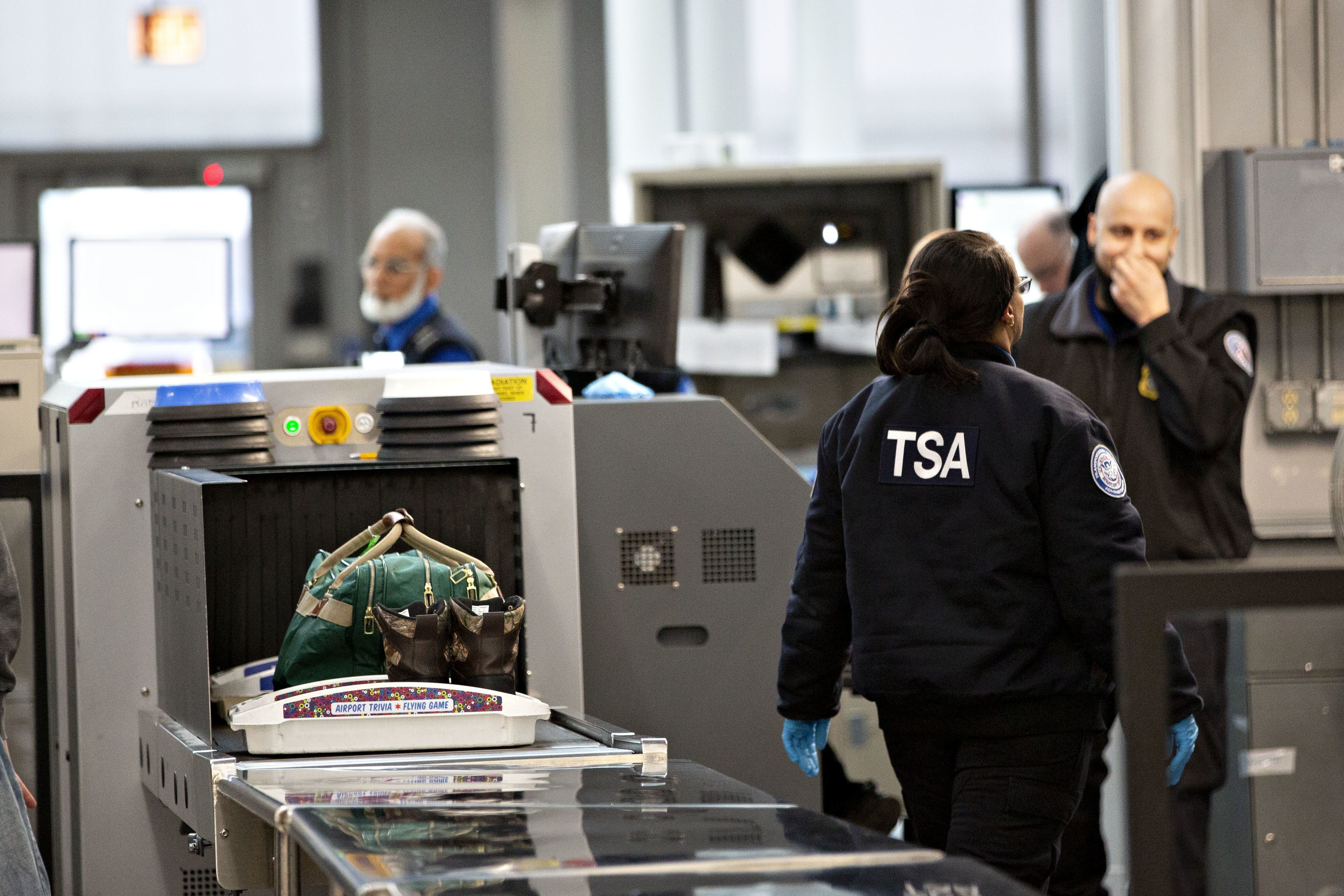 Transportation Security Administration (TSA) agents work at a check-point inside O'Hare International Airport (ORD) in Chicago, Illinois, U.S., on Tuesday, Jan. 8, 2019. With screeners already calling in sick in larger-than-normal numbers, U.S. airports are girding for disruptions next week if the partial government shutdown continues and TSA officers miss their first paycheck. Photographer: Daniel Acker/Bloomberg via Getty Images