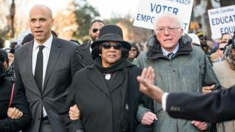 COLUMBIA, SC - JANUARY 21: U.S. Sen. Bernie Sanders (I-VT), right, president of the South Carolina NAACP chapter, Brenda Murphy, center, and Sen. Cory Booker (D-NJ) march to the Statehouse in commemoration of Martin Luther King Jr. Day on January 21, 2019 in Columbia, South Carolina. The South Carolina chapter of the NAACP will mark the occasion with King Day at the Dome. (Photo by Sean Rayford/Getty Images)