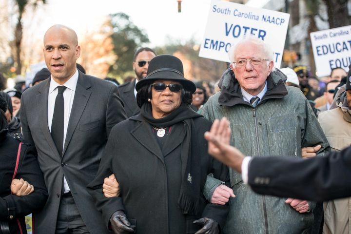 Sen. Cory Booker (D-N.J.), left, and Sen. Bernie Sanders (I-Vt.) attend an NAACP rally in South Carolina, a sign of how