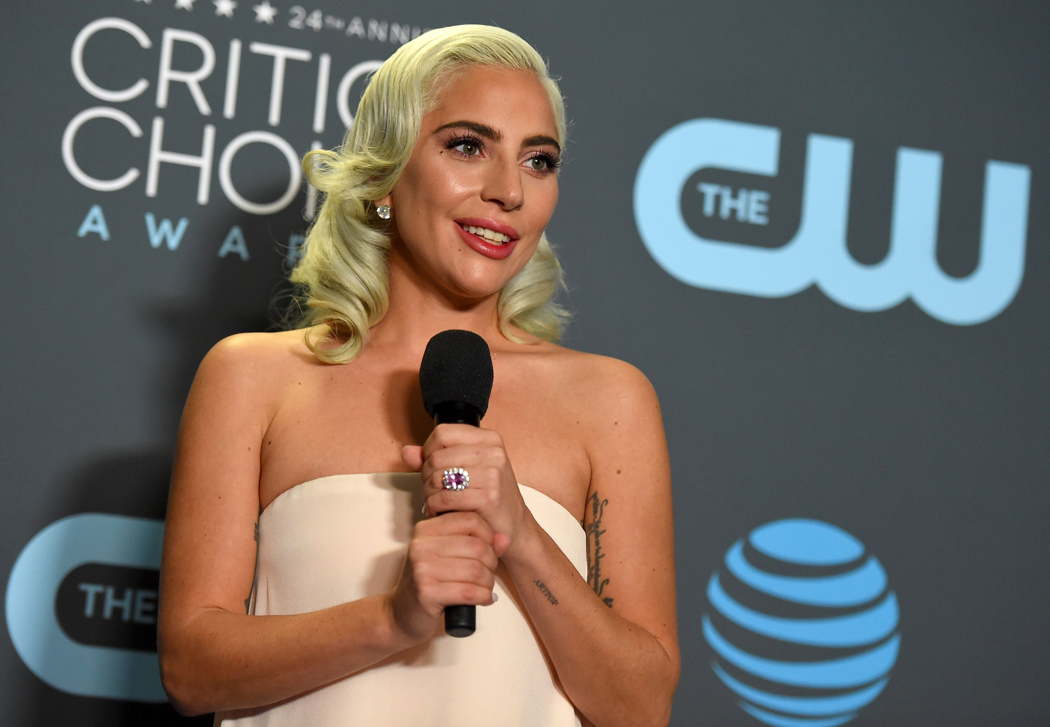 """Lady Gaga, winner of the award for best song for """"Shallow"""" from """"A Star Is Born,"""" poses in the press room at the 24th annual Critics' Choice Awards on Sunday, Jan. 13, 2019, at the Barker Hangar in Santa Monica, Calif. (Photo by Jordan Strauss/Invision/AP)"""