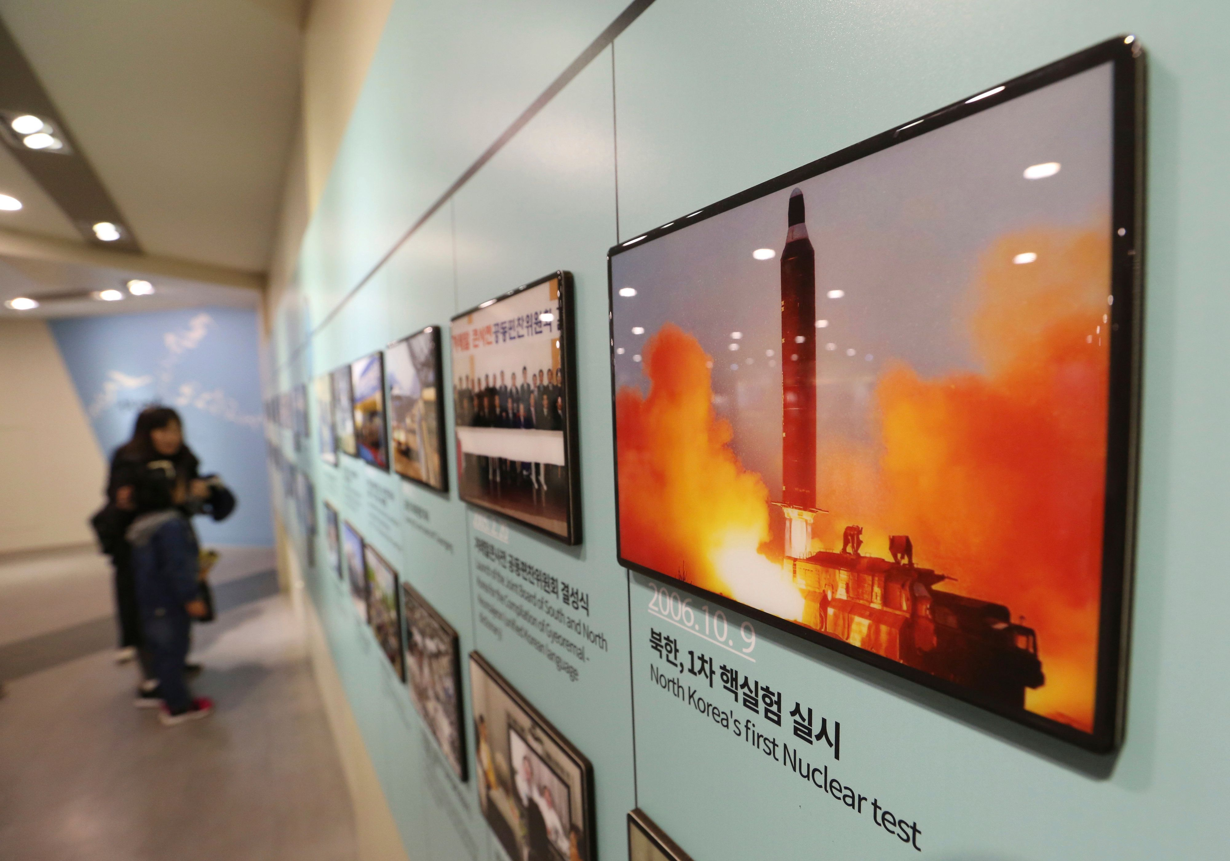 """A photo showing North Korea's missile launch is displayed at the Unification Observation Post in Paju, near the border with North Korea, South Korea, Friday, Nov. 16, 2018. North Korean leader Kim Jong Un observed the successful test of an unspecified """"newly developed ultramodern tactical weapon,"""" state media reported Friday, in an apparent bid to apply pressure on the United States and South Korea amid a stalemated nuclear diplomacy.(AP Photo/Ahn Young-joon)"""