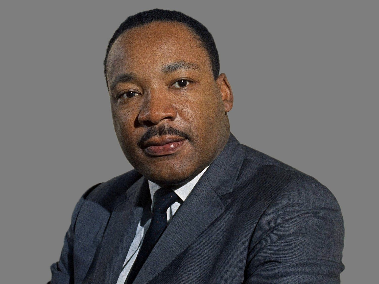 Martin Luther King Jr headshot, civil rights leader, graphic element on gray