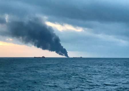 Smoke rises from a fire at a ship in the Kerch Strait near Crimea January 21,