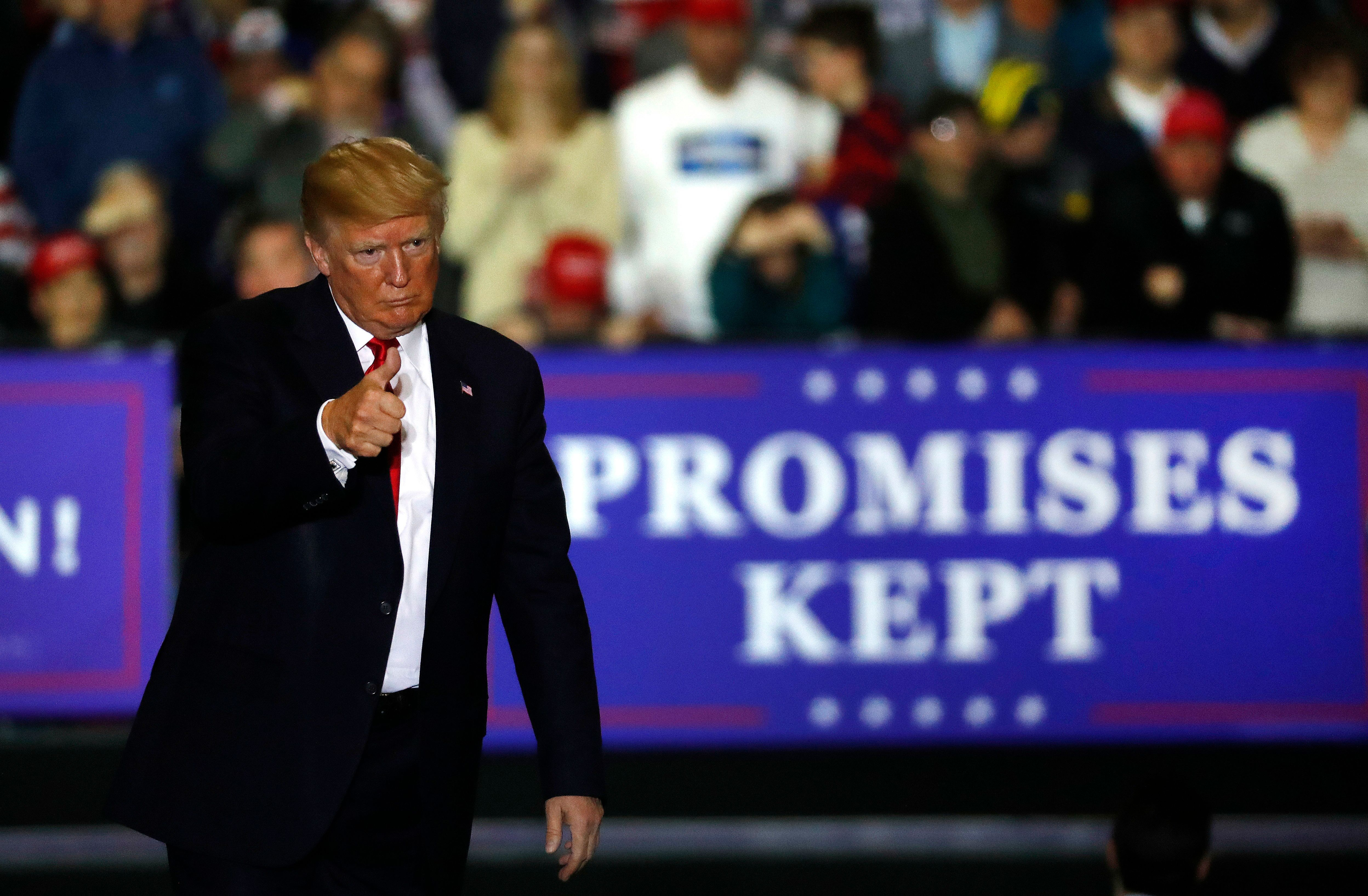 U.S. President Donald Trump gives a thumbs-up during a campaign rally in Washington Township, Mich., Saturday, April 28, 2018. (AP Photo/Paul Sancya)