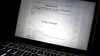 FILE - In this Nov. 6, 2018, file photo, a document from the website of China's Trademark Office of the State Administration for Industry and Commerce showing provisional approval of a trademark for Ivanka Trump Marks LLC is seen on a computer screen in Beijing. China has greenlighted five more Ivanka Trump trademarks as trade talks with her father's administration intensify. They cover a range from wedding dresses to insurance and art valuation services. (AP Photo/Mark Schiefelbein, File)