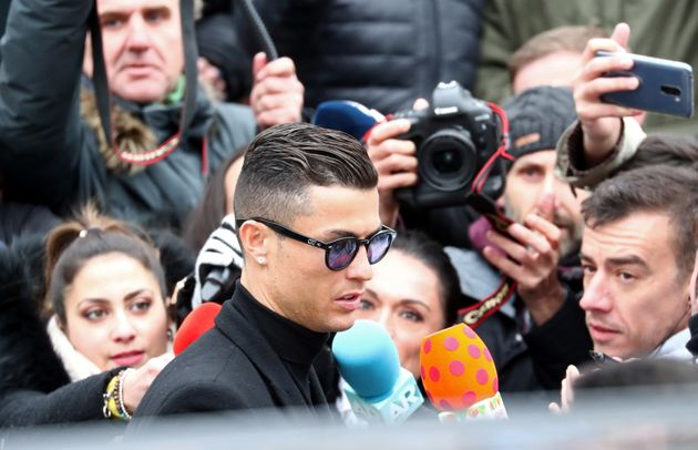 Cristiano Ronaldo leaves court in Madrid after accepting a deal in an ongoing tax fraud