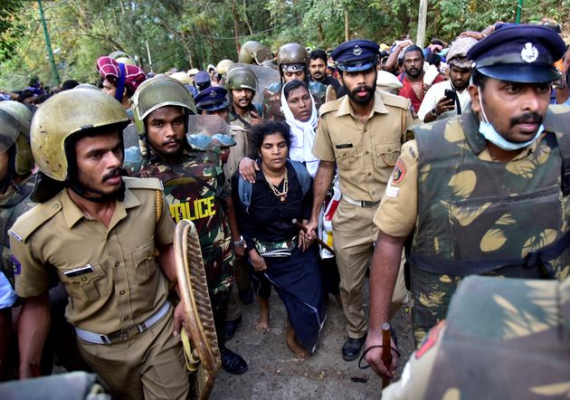 Bindu Ammini and Kanakadurga escorted by police after they attempted to enter the Sabarimala