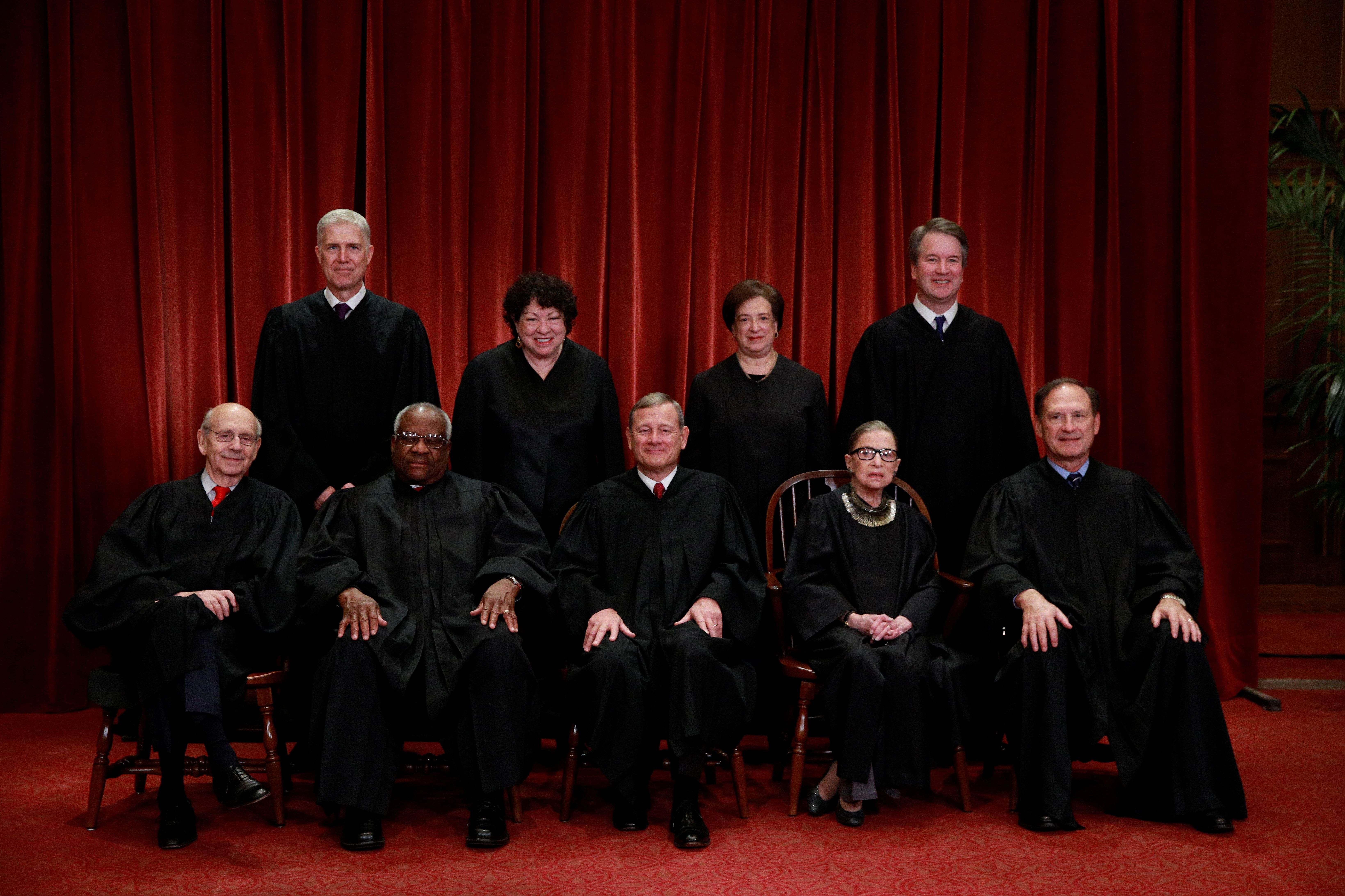 U.S. Supreme Court justices pose for their group portrait at the Supreme Court in Washington, U.S., November 30, 2018. Seated (L-R): Associate Justice Stephen Breyer, Associate Justice Clarence Thomas, Chief Justice of the United States John G. Roberts, Associate Justice Ruth Bader Ginsburg and Associate Justice Samuel Alito, Jr. Standing behind (L-R): Associate Justice Neil Gorsuch, Associate Justice Sonia Sotomayor, Associate Justice Elena Kagan and Associate Justice Brett M. Kavanaugh  REUTERS/Jim Young