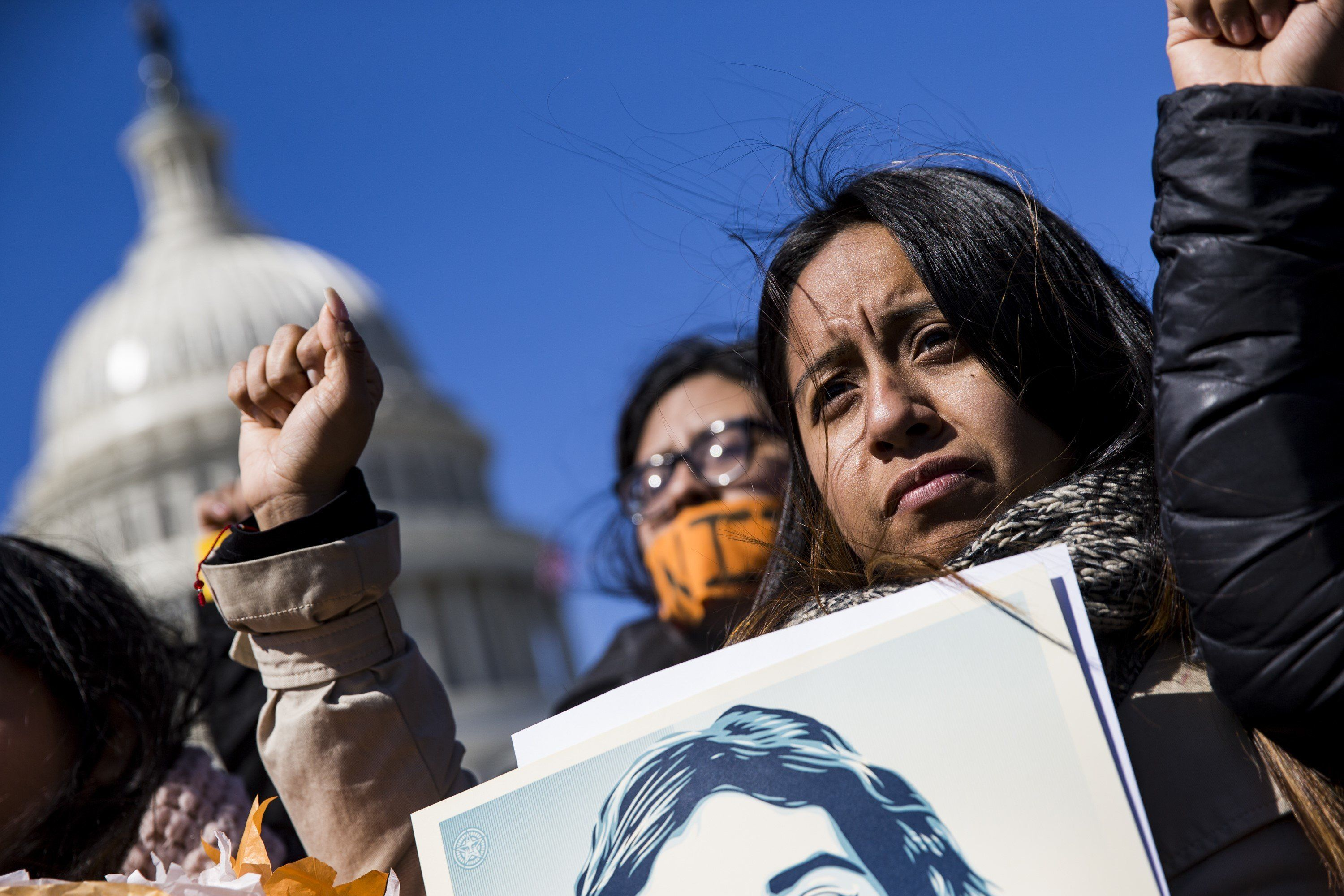WASHINGTON, USA - MARCH 5: Demonstrators raise their fists in protest of President Trump's attempts to end the Deferred Action for Childhood Arrivals (DACA), an executive action made by President Obama that protected minors known as Dreamers who entered the country illegally from deportation, outside of the U.S. Capitol in Washington, USA on March 5, 2018. (Photo by Samuel Corum/Anadolu Agency/Getty Images)