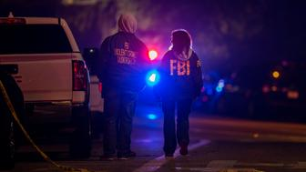 THOUSAND OAKS, CA - NOVEMBER 08: F.B.I. agents monitor the scene near the Borderline Bar and Grill, where a mass shooting occurred, on November 8, 2018 in Thousand Oaks, California. According to reports, at least 12 people have died, including a Ventura County Sheriffs Department sergeant, plus the gunman.  (Photo by David McNew/Getty Images)