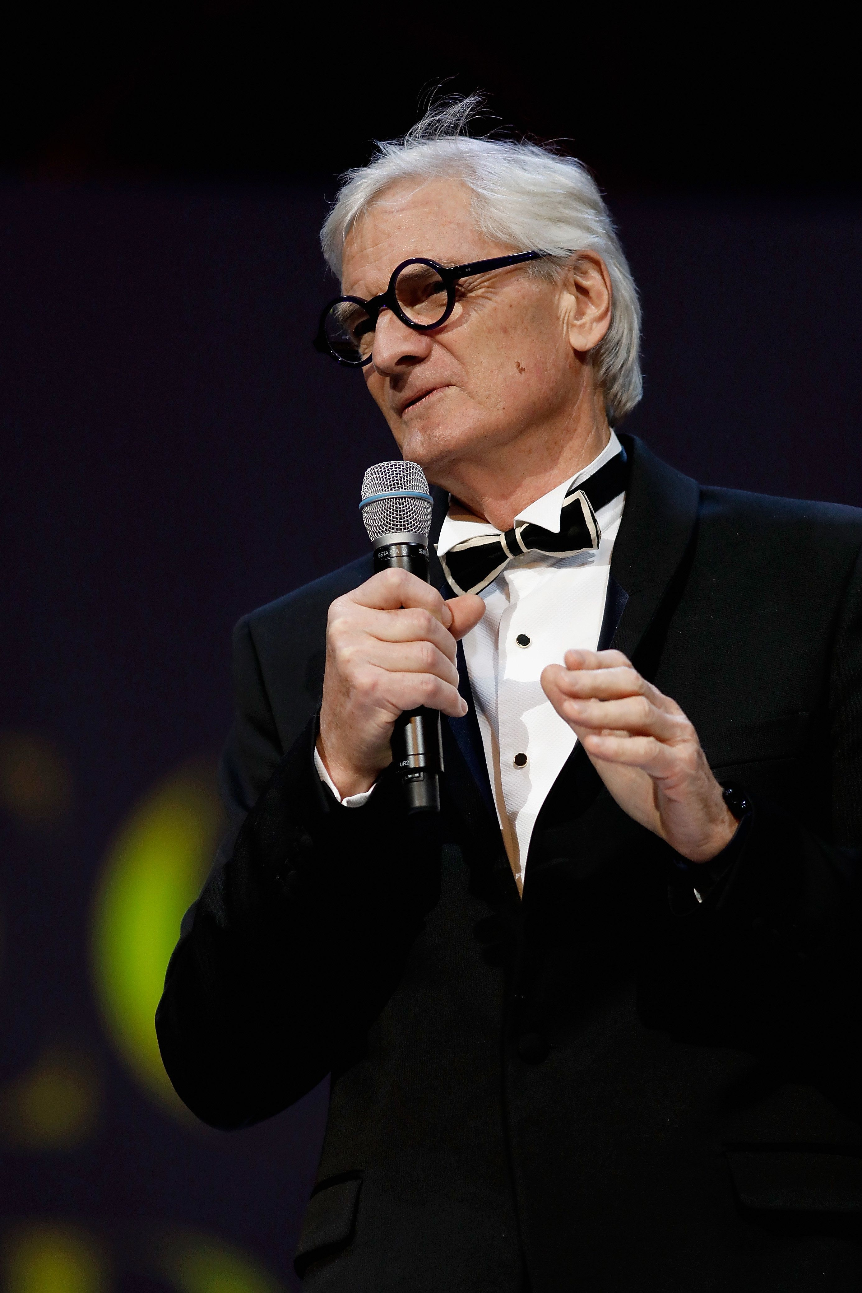 Sir James Dyson presents the Special Recognition award for Innovation on stage during The Fashion Awards