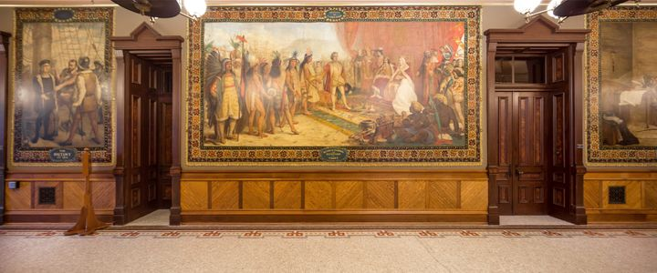 An October 2015 photo shows a Columbus mural in Notre Dame's Main Building.
