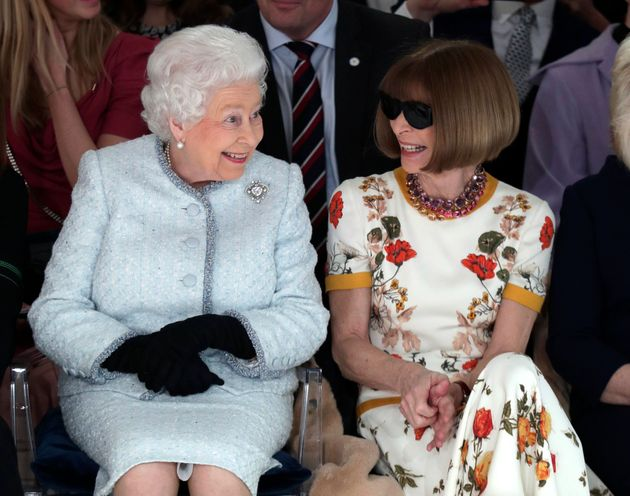 Queen Elizabeth sits next to Anna Wintour as they view Richard Quinn's runway show on Feb. 20,