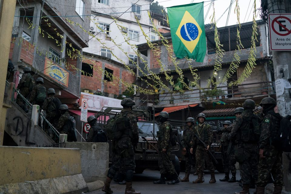 Soldiers patrol a neighborhood in the Mangueira favela in Rio during an operation in