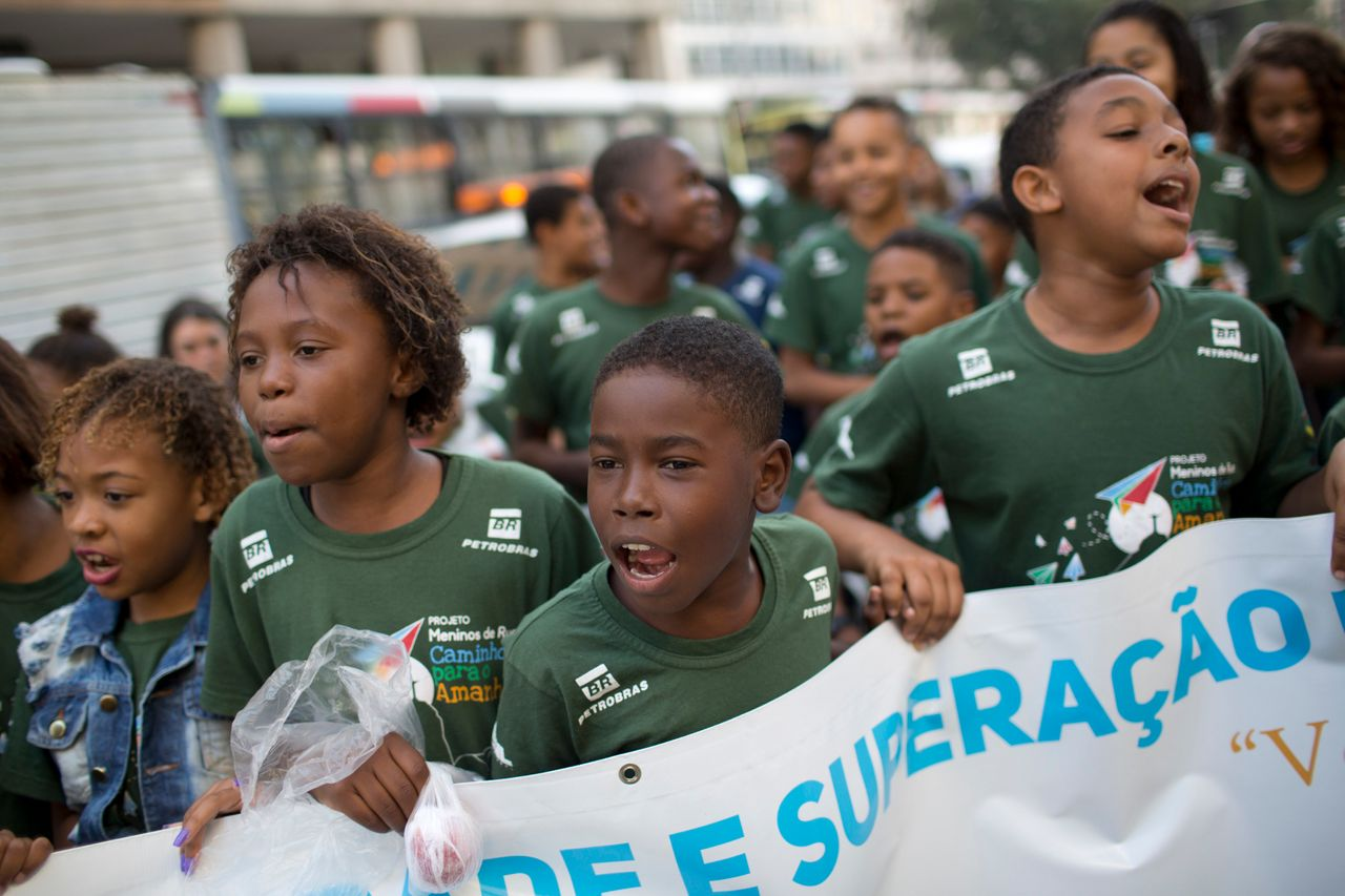 Children in Rio protest violence against black people during a march marking the 25th anniversary of the July 1993 Candelária massacre, when police killed at least eight people, including six minors, outside a cathedral.