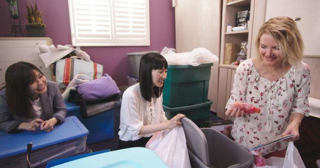Marie Kondo (center), with interpreter Marie Iida (left), helps recently widowed Margie declutter her...