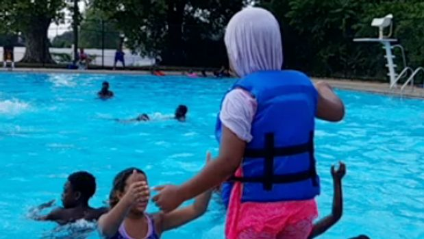 Students ranging from 5 to 12 years old who participated in the annual summer youth program were brought to the Foster Brown pool every summer for the last 4 years. During this time, some girls in the program preferred to wear cotton T-shirts and leggings in the pool while others covered their hair with headscarves when they swam.