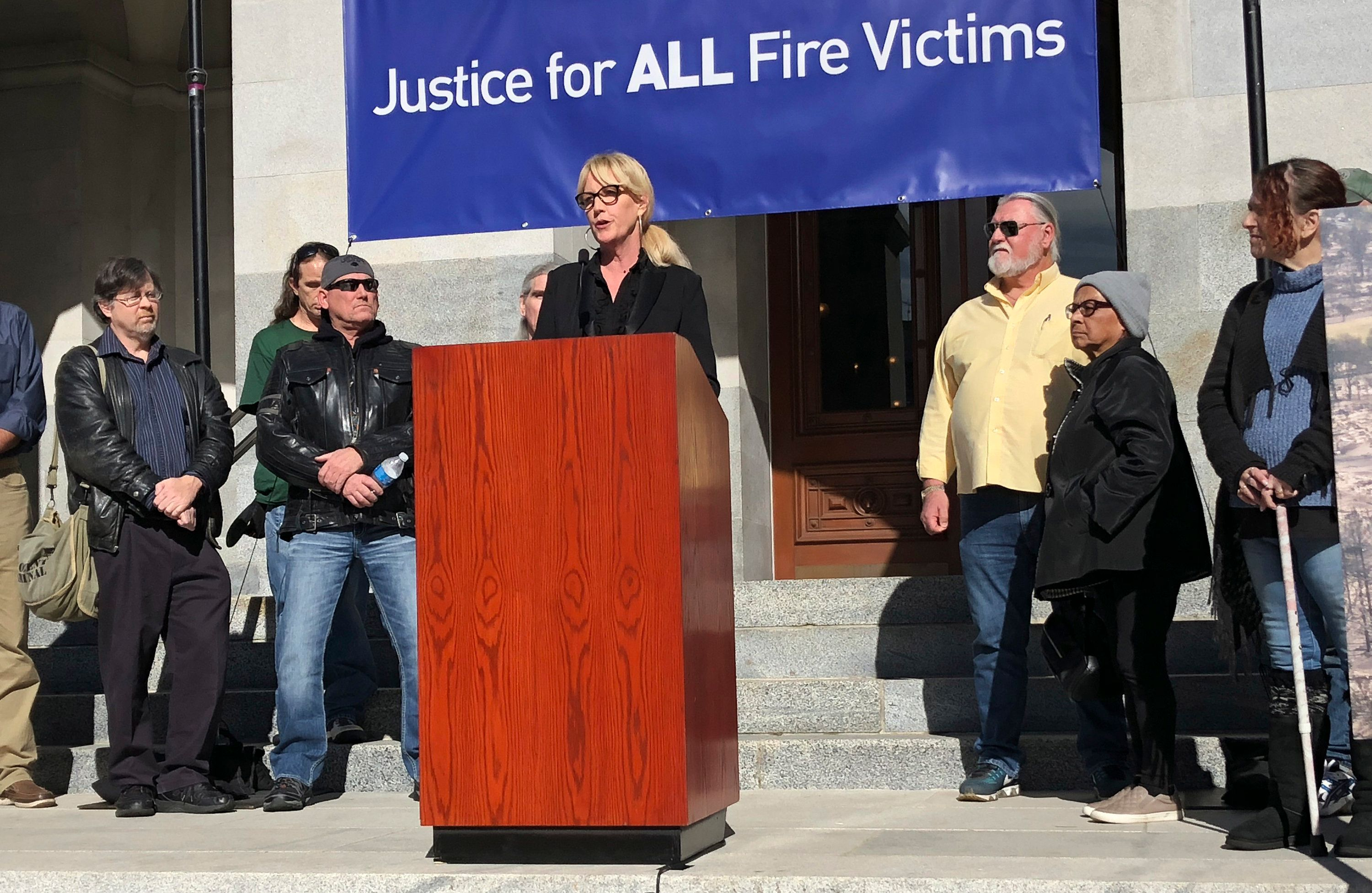 <p> Consumer advocate Erin Brockovich, who famously took on Pacific Gas & Electric Co. in the 1990s, stands with wildfire victims and speaks outside the state Capitol Tuesday, Jan. 22, 2019, in Sacramento, Calif. Brockovich is urging California lawmakers not to let PG&E go bankrupt because it might mean less money for wildfire victims. (AP Photo/Kathleen Ronayne) </p>