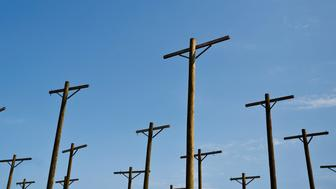 In this Wednesday, Sept. 7, 2016 photo, a row of telephone poles line the skyline outside of the Bellefonte Nuclear Plant, in Hollywood, Ala. The Tennessee Valley Authority has set a minimum bid of $36.4 million for its unfinished Bellefonte Nuclear Plant and the 1,600 surrounding acres of waterfront property on the Tennessee River. (AP Photo/Brynn Anderson)