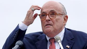 FILE - In this Aug. 1, 2018 file photo, Rudy Giuliani, an attorney for President Donald Trump, speaks in Portsmouth, N.H. Giuliani's latest scattershot media blitz, which was filled with a dizzying array of wild misstatements, hurried clarifications and eyebrow-raising assertions, agitated President Donald Trump and some of his allies. (AP Photo/Charles Krupa, File )