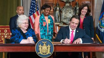 ADDS NAMES OF OTHERS WITH CUOMO - In this photo provided by the Office of Gov. Andrew M. Cuomo, Cuomo, right, signs Reproductive Health Act Legislation during a ceremony, Tuesday, Jan. 22, 2019, in the Red Room at the State Capitol in Albany, N.Y. With the new law, New York state enacts one of the nation's strongest protections for abortion rights, a move that state leaders say was needed to safeguard those rights should the U.S. Supreme Court overturn Roe v. Wade. Also pictured are attorney Sarah Weddington, front left, who successfully argued Roe v Wade before the Supreme Court; New York State assembly Speaker Carl Heastie, back left; New York State Senate Leader Andrea Stewart-Cousins, D-Yonkers, standing center; and Democratic Lt. Gov Kathy Hochul, back right. (Darren McGee/Office of Gov. Andrew M. Cuomo via AP)