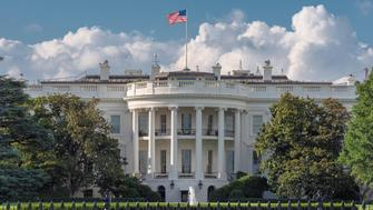 The White House in Washington DC at sunny day, is the home and residence of the President of the United States of America and popular tourist attraction