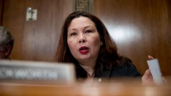 Sen. Tammy Duckworth, D-Ill., questions Andrew Wheeler as he testifies at a Senate Environment and Public Works Committee hearing to be the administrator of the Environmental Protection Agency, on Capitol Hill in Washington, Wednesday, Jan. 16, 2019. (AP Photo/Andrew Harnik)
