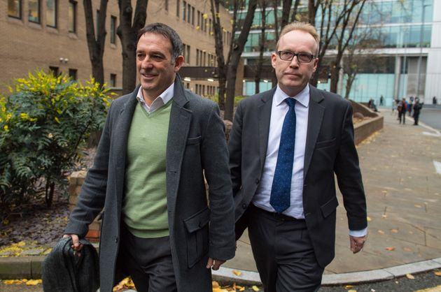 Former Tesco UK managing director Chris Bush (left) leaves Southwark Crown Court, in London, after being...