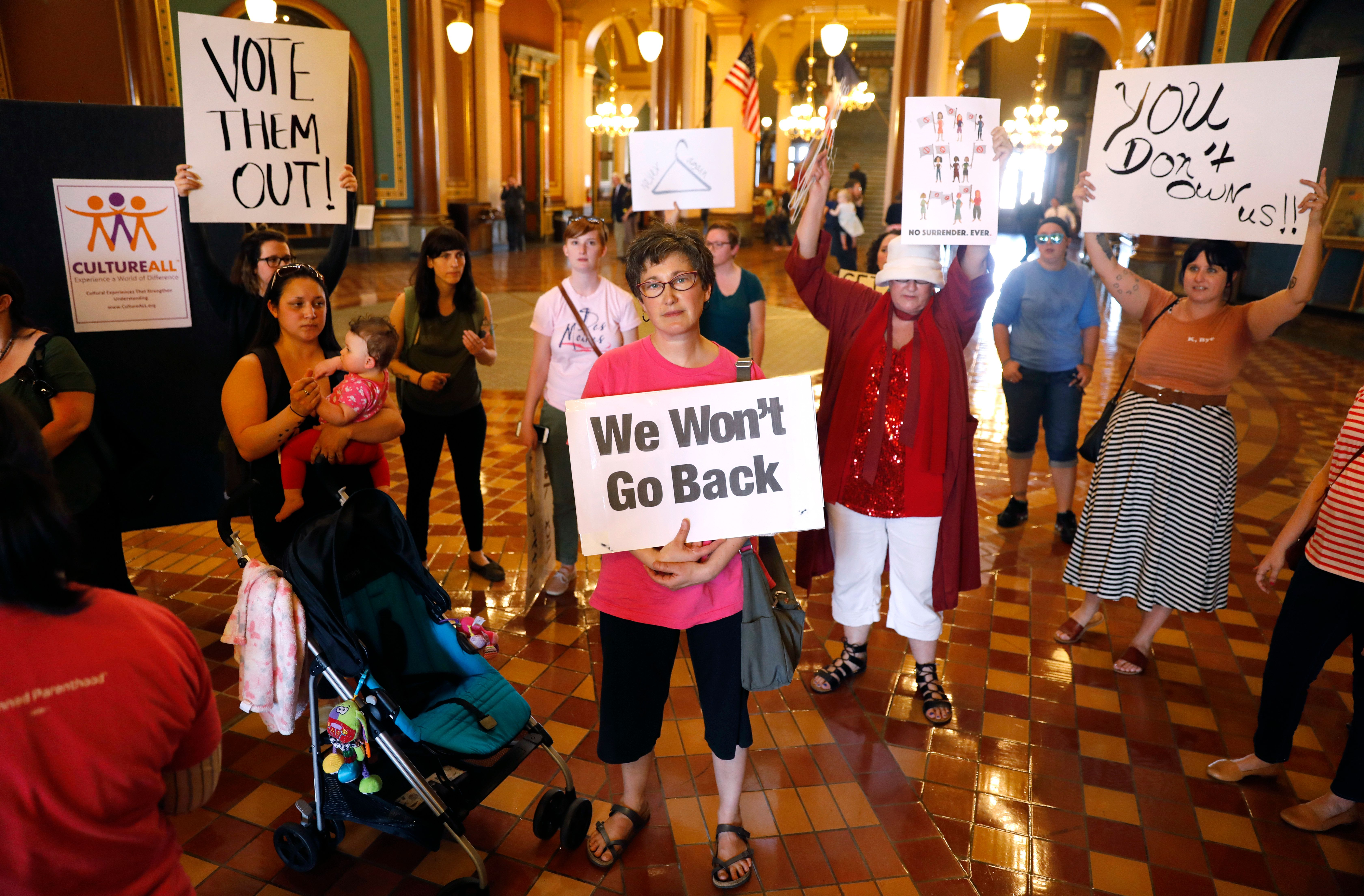 Protesters rally outside Iowa Gov. Kim Reynolds' office, on May 4, 2018, at the Statehouse in Des Moines.
