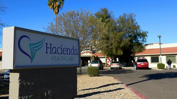 FILE - This Friday, Jan. 4, 2019, file photo shows Hacienda HealthCare in Phoenix. State regulators reportedly wanted to remove developmentally disabled patients from a Phoenix long-term care facility years before a woman in a vegetative state gave birth. The Arizona Republic reported Sunday, Jan. 13, 2019, that Hacienda HealthCare faced a criminal investigation in 2016. The facility allegedly billed the state some $4 million in bogus 2014 charges for wages, transportation, housekeeping, maintenance and supplies. (AP Photo/Ross D. Franklin, File)