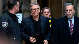 Actor Alec Baldwin(C) departs New York County Criminal Court January 23, 2019 in New York. - Alec Baldwin pleaded guilty to a second-degree harassment violation stemming from when he punched a man during a dispute over a New York City parking spot late last year. (Photo by Don EMMERT / AFP)        (Photo credit should read DON EMMERT/AFP/Getty Images)