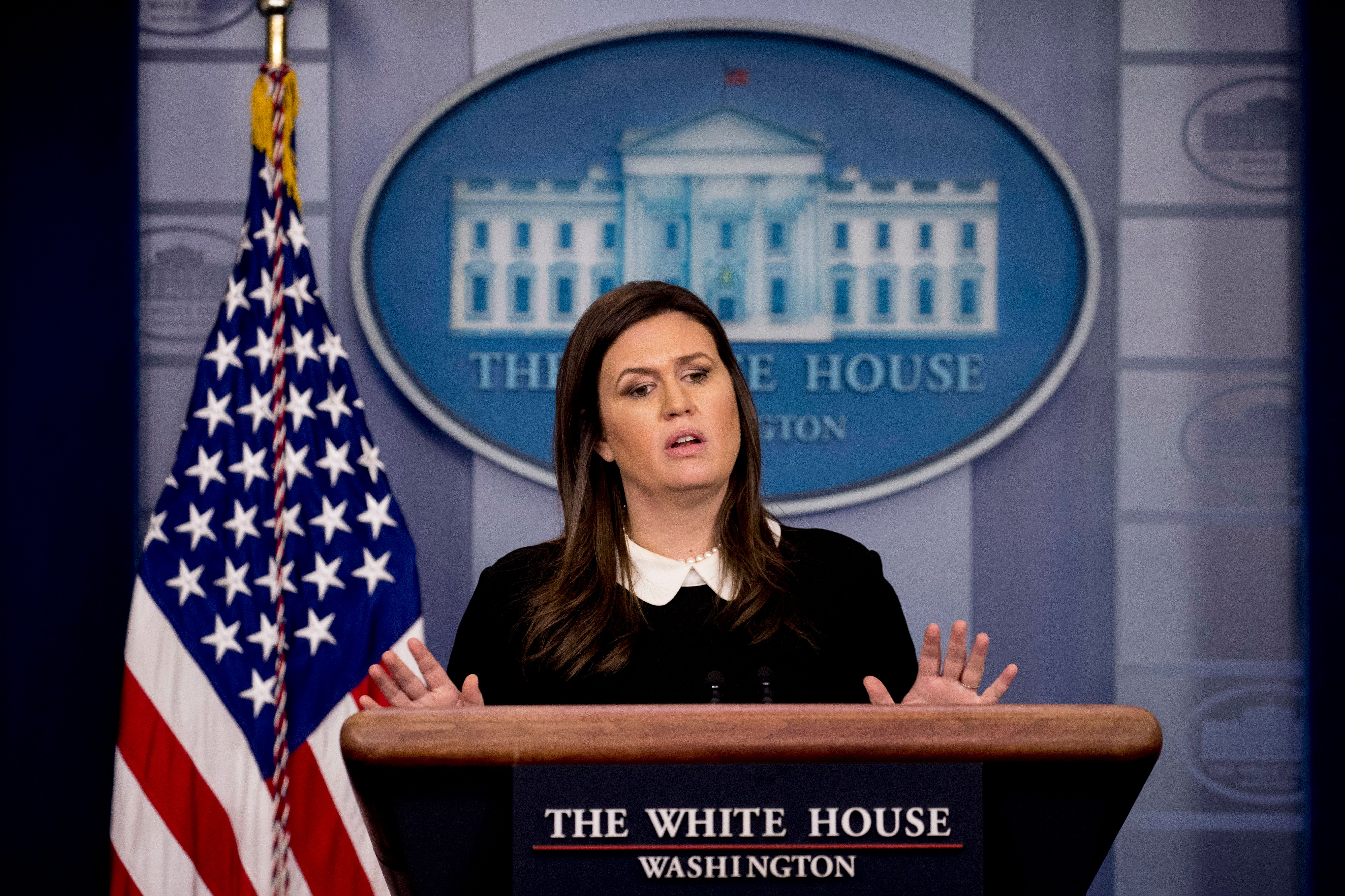 White House press secretary Sarah Huckabee Sanders calls on a reporter during the daily press briefing at the White House, Tuesday, Dec. 18, 2018, in Washington. Sanders discussed the delayed sentencing for former national security adviser Michael Flynn and other topics. (AP Photo/Andrew Harnik)