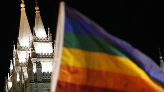 A rainbow flag representing gay pride waves outside of Temple Square along North Temple Street Friday Nov. 7, 2008. According to police an estimated 2,000 protestors gathered near the Salt Lake LDS Temple this evening, carrying signs defending gay marriage and attacking Mormon officials for the church's active campaigning on behalf of California's Proposition 8. (AP Photo/Chris Detrick - The Salt Lake Tribune) -UTSAL, Deseret News Out, Local TV Out, Mags Out
