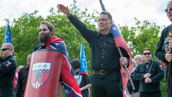 Members of the National Socialist Movement (NSM) and other white nationalists rally at Greenville Street Park in Newnan, Georgia on April 21, 2018. - Only about 25 NSM and white nationalists turned up for the rally in the park, while counter-protesters showed up in the hundreds. (Photo by BITA HONARVAR / AFP)        (Photo credit should read BITA HONARVAR/AFP/Getty Images)