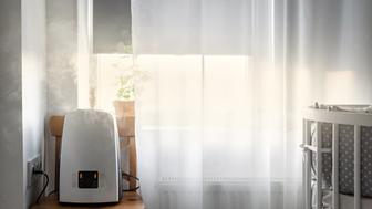 Modern air humidifier near the window in the children's room. Health and air purification.