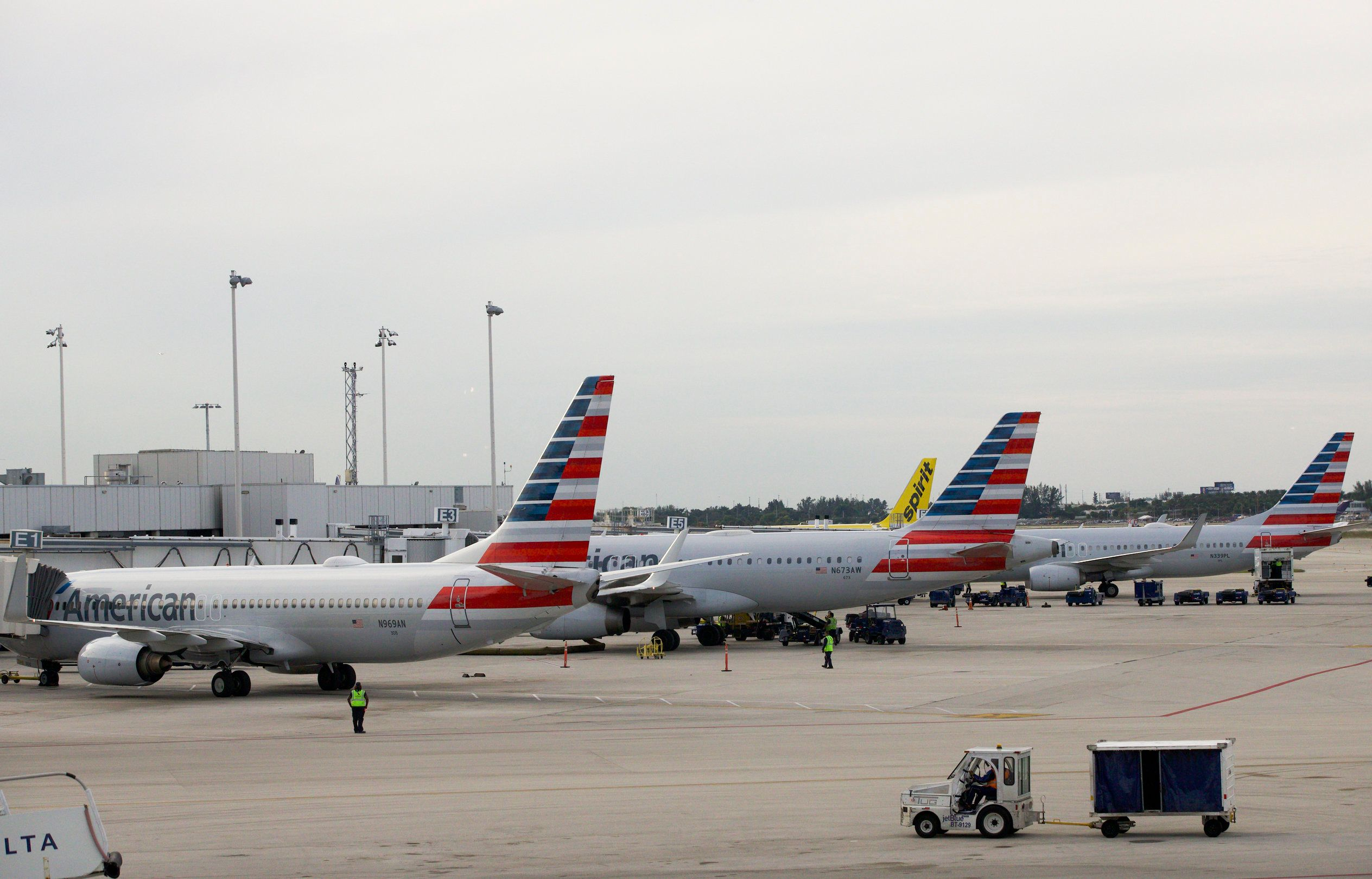 In this Thursday, Nov. 29, 2018 photo, American Airlines planes are parked at the gates at Fort Lauderdale–Hollywood International Airport in Fort Lauderdale, Fla. (AP Photo/Wilfredo Lee)