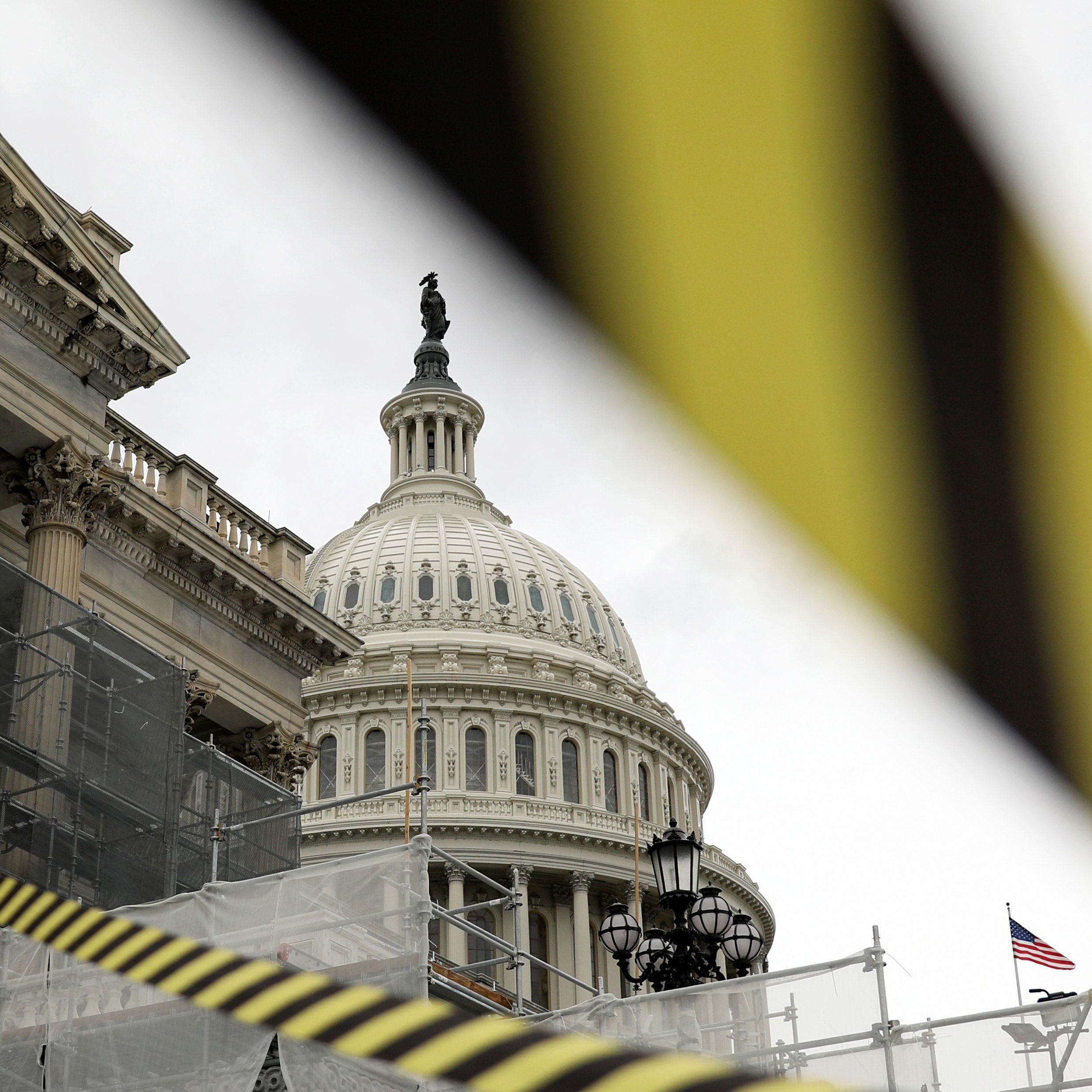 Construction fencing and caution tape surround part of the U.S. Capitol building in Washington, U.S. November 2, 2018. REUTERS/Jonathan Ernst