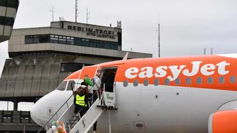 Passengers board an easyJet plane at Tegel Airport in Berlin, Germany, Friday, Jan. 5,  2018 for the British airline's first domestic flight within Germany. (Jens Kalaene/dpa via AP)
