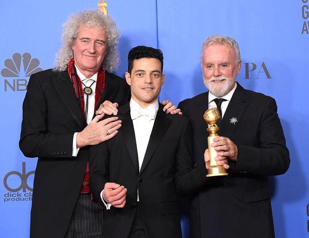 Brian May with 'Bohemian Rhapsody' star Rami Malek and drummer Roger
