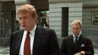 Billionaire real estate developer Donald Trump, left, walks to the Federal Courthouse in Newark, N.J., with Roger Stone, the director of Trump's presidential exploratory committee Monday, Oct. 25, 1999, for the swearing-in of Trump's sister as a federal appeals court judge. In a prelude to his possible presidential bid, Trump quit the Republican Party Monday and joined New York's wing of the Reform Party setting the stage for a possible presidential nomination battle with Pat Buchanan. (AP Photo/Daniel Hulshizer)