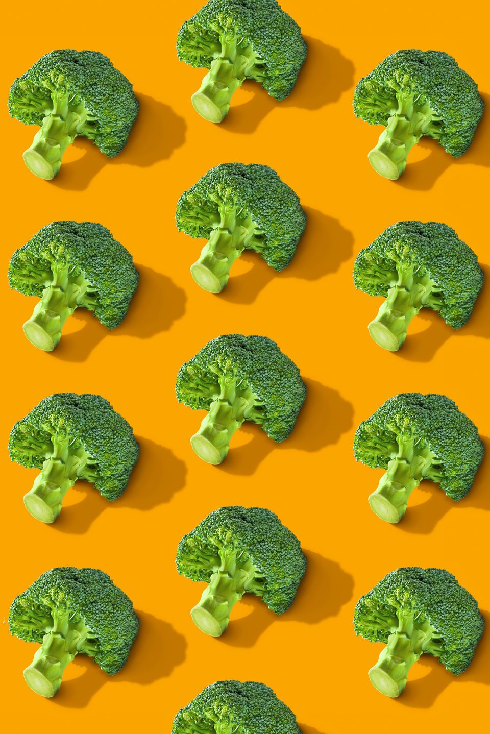 Colorful vegetables pattern of fresh hot broccolis on color background. From top view