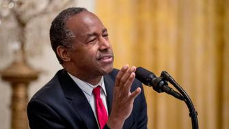 FILE - In this Oct. 26, 2018, file photo, Housing and Urban Development Secretary Ben Carson speaks at the 2018 Young Black Leadership Summit at the White House in Washington. The federal government shutdown has scrambled plans for a Missouri prayer breakfast after Ben Carson had to cancel as the keynote speaker Thursday, Jan. 10, 2019. A spokesman for the U.S. Department Housing and Urban Development said Wednesday, Jan. 9, 2019, that the agency could not pay for the secretary's travel to Missouri because of the shutdown. (AP Photo/Andrew Harnik, File)