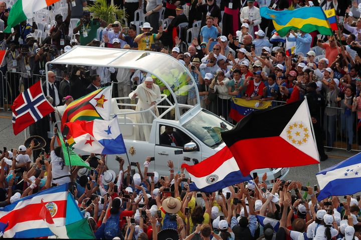 Pope Francis arrives in the popemobile to attend the opening ceremony for World Youth Day at the Coastal Beltway in Panama Ci