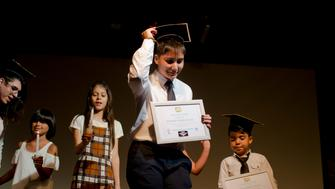 In this Dec.18, 2018 photo, transgender student Sebastian, center, carries his diploma after his graduation ceremony at the Amaranta Gomez school in Santiago, Chile. Classes began in April 2018 at a spaced loaned by a community center in the Chilean capital of Santiago. (AP Photo/Esteban Felix)