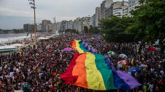 TOPSHOT - A giant rainbow flag is pictured during the Gay Pride parade at Copacabana beach in Rio de Janeiro, Brazil on September 30, 2018. (Photo by Mauro Pimentel / AFP)        (Photo credit should read MAURO PIMENTEL/AFP/Getty Images)