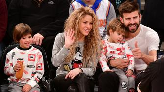 NEW YORK, NY - DECEMBER 25:  Milan Pique Mebarak, Shakira, Sasha Pique Mebarak and Gerard Pique attend the New York Knicks Vs Philadelphia 76ers game at Madison Square Garden on December 25, 2017 in New York City.  (Photo by James Devaney/Getty Images)