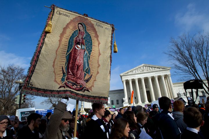Anti-abortion demonstrators pass the Supreme Court during the March for Life, Jan. 18. The Covington students were in th