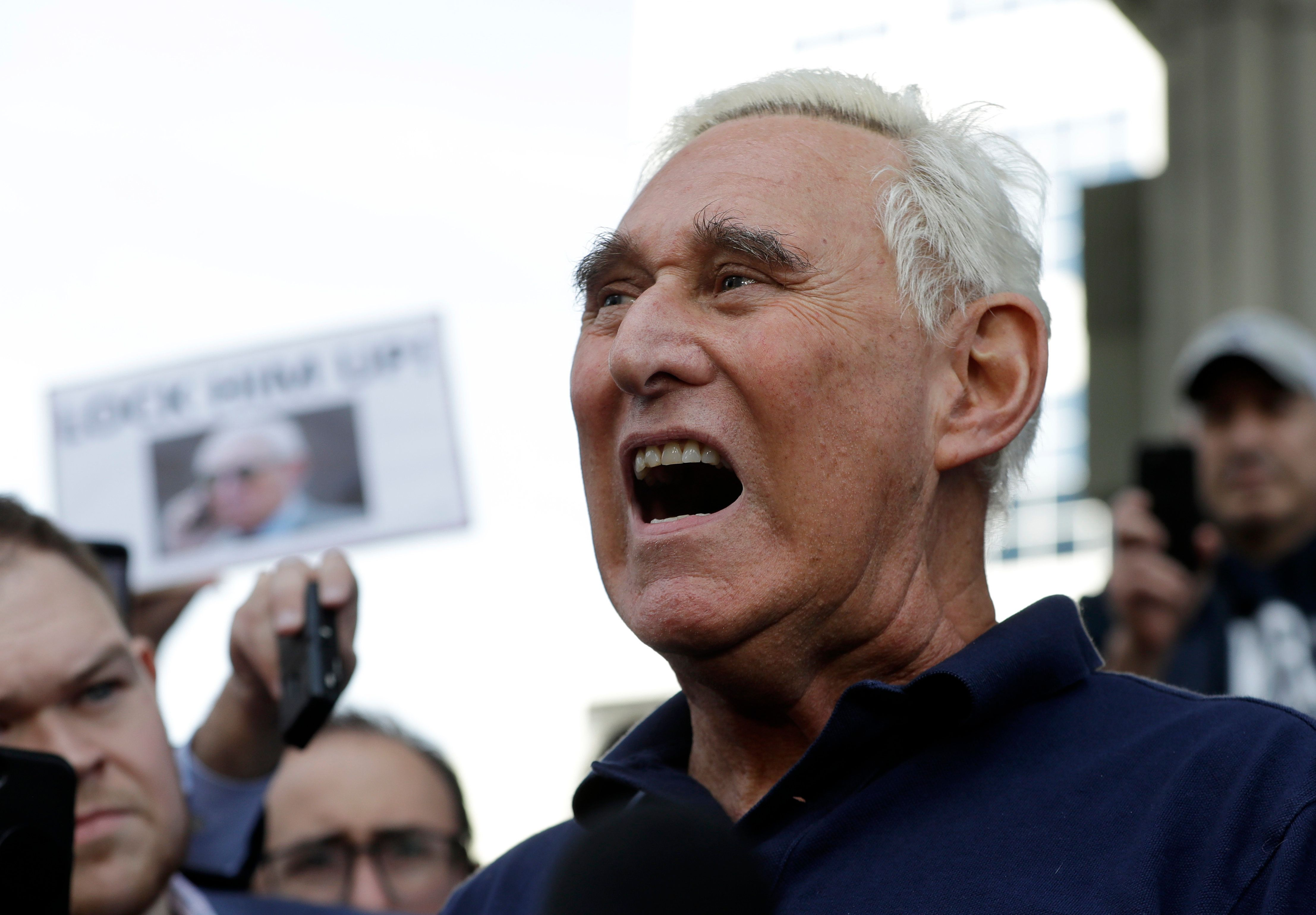 Roger Stone, a confidant of President Donald Trump, speaks outside of the federal courthouse following a hearing, Friday, Jan. 25, 2019, in Fort Lauderdale, Fla. Stone was arrested Friday in the special counsel's Russia investigation and was charged with lying to Congress and obstructing the probe. (AP Photo/Lynne Sladky)