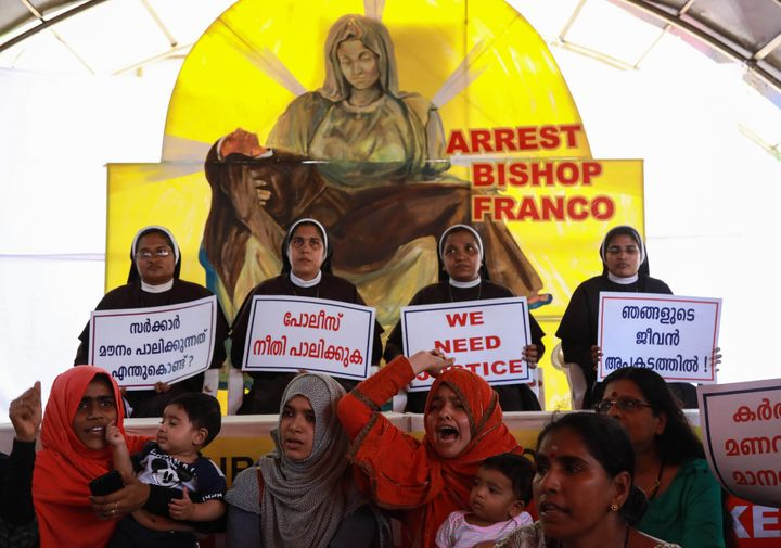 Indian Christian nuns and Muslim supporters protest as they demand the arrest of Bishop Franco Mulakkal, who is accused of raping a nun, outside the High Court in Kochi in the southern Indian state of Kerala on September 13, 2018 - Indian police on September 12 summoned for questioning a bishop accused by a nun of raping her multiple times, following days of protests by other nuns and supporters. Bishop Franco Mullackal, who has rejected the accusations, has been called for questioning in the southern state of Kerala on September 19, the Press Trust of India reported. (Photo by - / AFP) (Photo credit should read -/AFP/Getty Images)